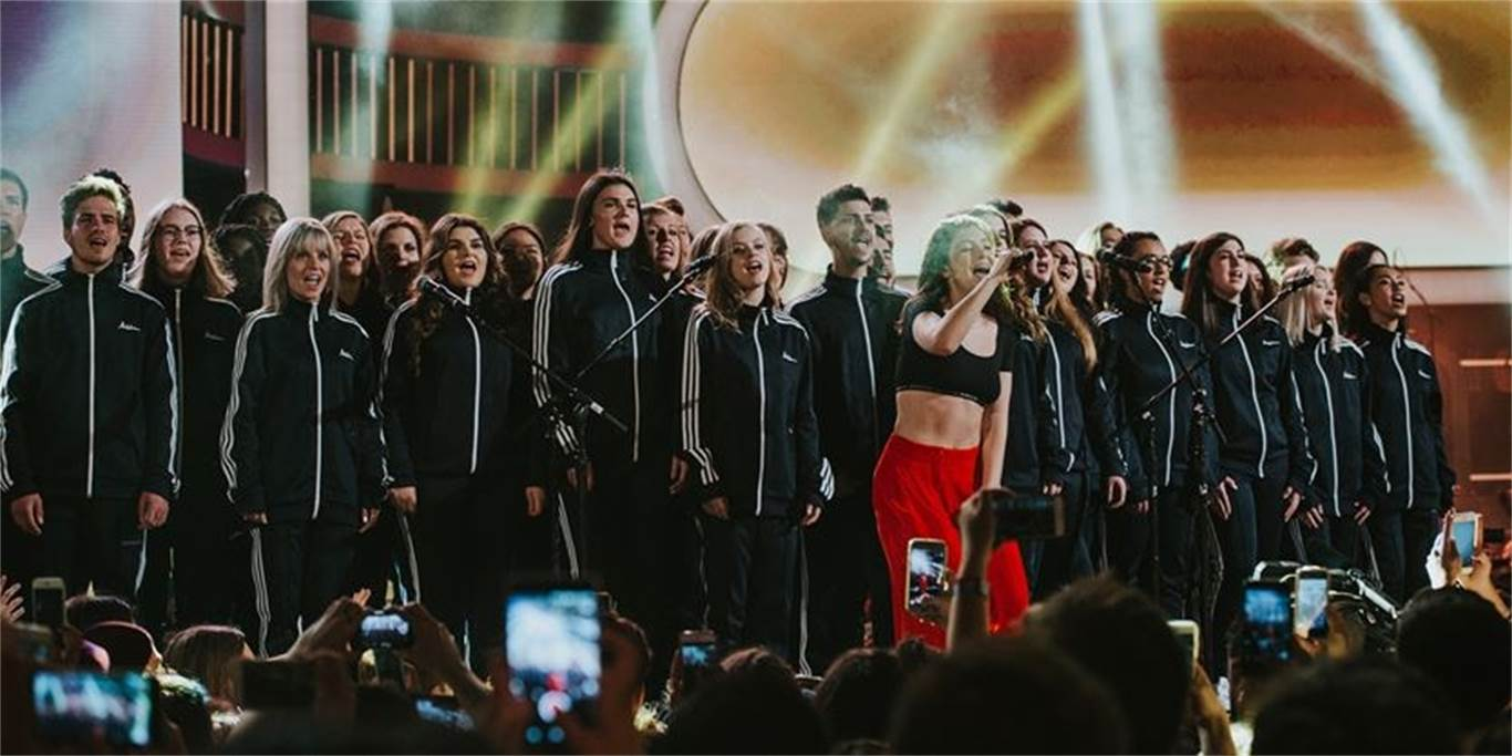 Forty Bishop Ryan Catholic Secondary School BR Xpression vocal ensemble members perform live on stage with pop artist Lorde during the grand finale of the iHeartRadio Much Music Video Awards on June 18 in Toronto. The choir was chosen for the gig from a pool of competitors. Photo by Steve Haining.
