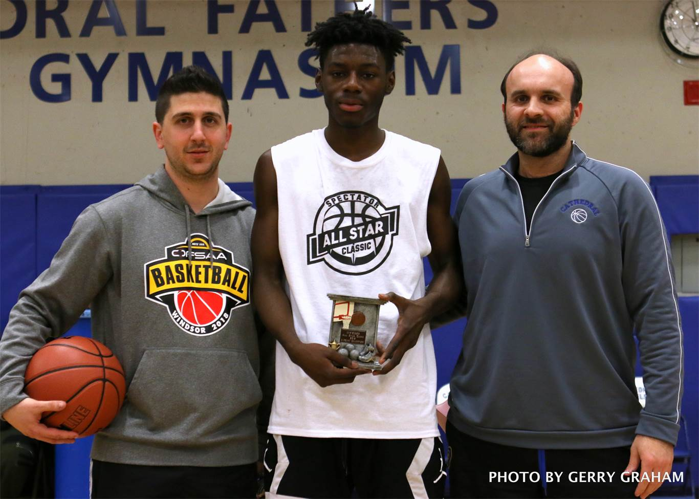 Nathan Bilamu of Cathedral was the winner of the halftime 3-point shooting contest. From left to right, Jae Dunphy, Biamu, Mario Susi. Photo by Gerry Graham.