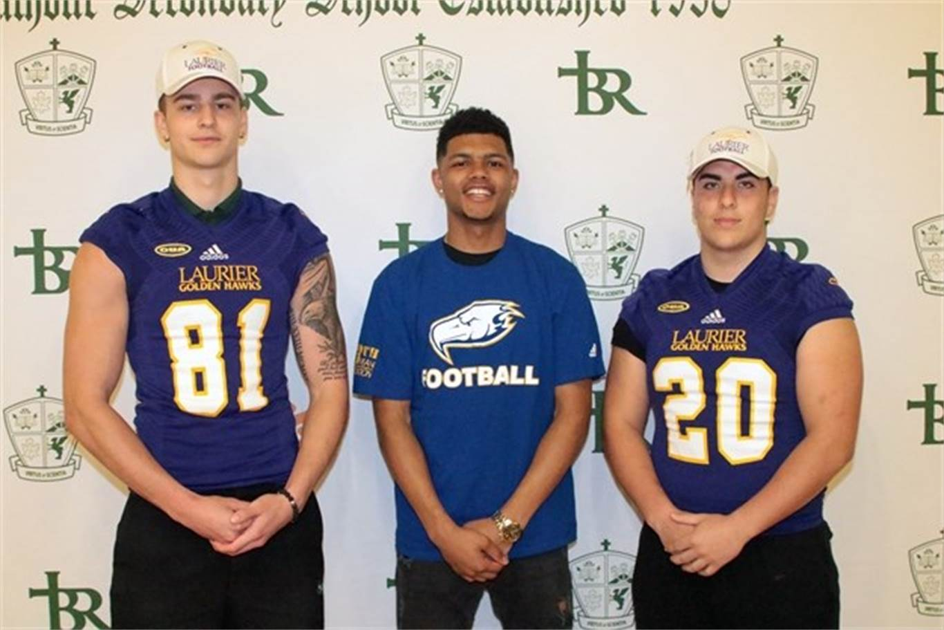 From left, Xavier Masotti, (Laurier), Jacob Patten (University of British Columbia) and Leo Hernandez, (Laurier) showed off the new team colours they will be wearing as U Sports football players this fall. Photo by Mike Pearson/Metroland.